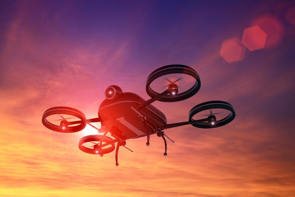 drone flying in the sky at sunset